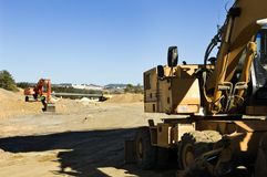 Excavators. In a road construction site Stock Photography