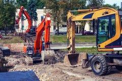 Excavators in the city. Three excavators in the city Royalty Free Stock Photo
