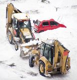 Excavators cleans snow blocked parking Stock Photography