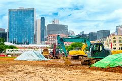 Excavators at construction site, Singapore Royalty Free Stock Photo