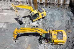 Excavators Baggers digging at a construction site Royalty Free Stock Image