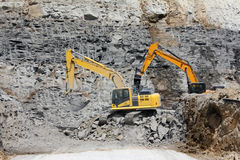 Excavators, Digging out Rock Stock Photo