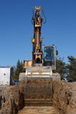 Excavators digging sewer trench Royalty Free Stock Images