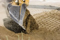 Excavators dumping its load of Royalty Free Stock Photos