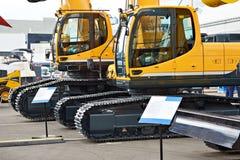 Free Excavators In Exhibition Stock Images - 121937984