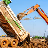 Excavators and large trucks Royalty Free Stock Photo