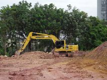Excavators machine is heavy construction machine used to excavate soil and lifting material. KUALA LUMPUR, MALAYSIA -APRIL 16, 2019: Excavators machine is heavy royalty free stock photography