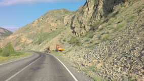 Excavators are near Chuysky Trakt in the Altai. Altai Republic, Russia - July 15, 2015: Excavators are near the Chuysky Trakt in the Altai Mountains stock video footage