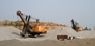 Excavators in an opencast mine Stock Images
