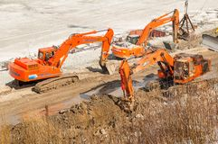 Excavators on pedestrian quay construction. Tyumen Stock Photo