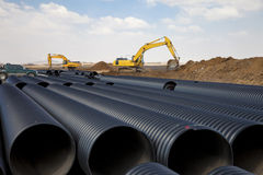 Excavators and pipes Stock Images