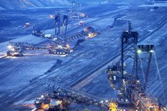 Excavators in a quarry. Large bucket wheel excavators in a lignite quarry at sunset, Germany stock photos
