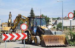 Excavators at the road construction. In the city Royalty Free Stock Photography