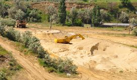 Excavators in the sand pit Royalty Free Stock Photos
