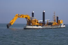 Excavators set out to sea Royalty Free Stock Images