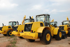 Excavators in stock yard Royalty Free Stock Images