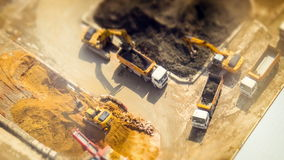 Excavators and tipper tracks at construction. Hong Kong. Time lapse, tilt shift stock video
