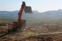 Excavators in work at the construction site Royalty Free Stock Photo