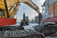 Excavators working for repair of water system Stock Photos