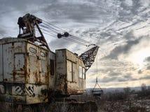 Excavatrice abandonnée Images libres de droits