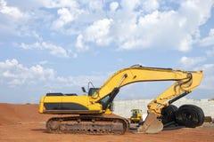 Excavatrice au chantier de construction Photographie stock