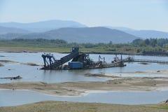 Excavatrice de boue de l'eau image libre de droits
