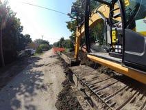 Excavatrice Digging Deep Image stock