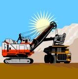 Excavatrice et camion à benne basculante Photo stock