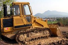 Excavatrice jaune Photos libres de droits