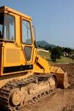 Excavatrice jaune Images libres de droits