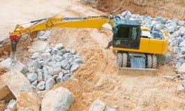 Excavatrice jaune image stock