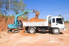 Excavatrice suivie Image libre de droits