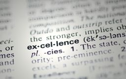 Excellence. The word excellence from the dictionary showing a shallow depth of field. Would make a great additon as part of a business presentation stock images