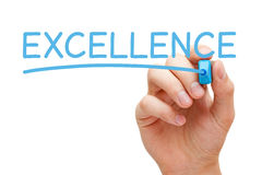 Excellence Blue Marker. Hand writing Excellence with blue marker on transparent wipe board royalty free stock photo
