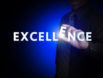 Excellence. Business hand and word Excellence stock images