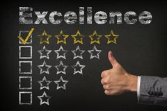 Excellence five 5 star rating. thumbs up service golden rating stars on chalkboard royalty free stock photo
