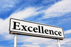 Excellence road sign. Against a background of blue sky with clouds royalty free stock images
