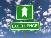 Excellence sign with up arrow. Large white on green road sign with the word excellence and an up arrow on a blue sky with clouds stock image