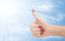 Excellent. Sign. Hand on sky background royalty free stock photography