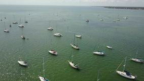 Excellent aerial drone 4k flight over small yacht motor boat sailing in calm blue harbor bay water in tropical seascape. Excellent aerial 4k drone flight over stock video footage