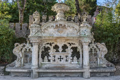 Excellent architectural bench in antique rococo style. Quinta Regaleira Sintra Portugal. Royalty Free Stock Image