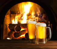 Excellent beer. On a background of fireplace royalty free stock photo