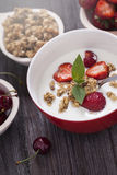 Excellent breakfast. Breakfast cereal with yoghurt and strawberr Stock Photo