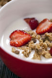 Excellent breakfast. Breakfast cereal with yoghurt and strawberr Stock Image
