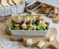 Excellent caesar salad with roasted pastry and chicken, sprinkled with parmesan cheese Stock Images
