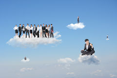Excellent cloud work. Asian businessman sit on cloud with confident and successful expression and give you an excellent gesture in front of his team Stock Image