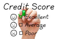 Excellent Credit Score. Hand putting check mark with green marker on excellent credit score evaluation form stock photography