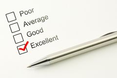 Excellent customer service feed back. Consumer satisfaction concept. Marked checkbox with a pen on paper background. Excellent customer service feed back stock photo