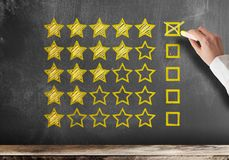 Five star customer feedback or client service rating on blackboard royalty free stock photos
