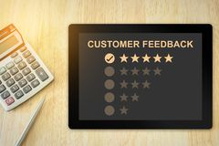 Excellent five stars customer feedback on tablet Stock Image